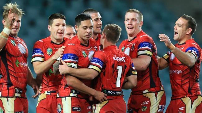 The Dragons celebrate a Joel Thompson try.