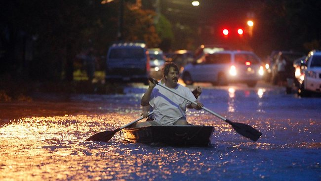 Two men paddle a boat bown a streete flooded by Hurricane Irene approaches Saturday, Aug. 27, 2011 in Manteo, N.C. Hurricane Irene knocked out power and piers in North Carolina, clobbered Virginia with wind and churned up the coast Saturday to confront cities more accustomed to snowstorms than tropical storms. (AP Photo/John Bazemore)