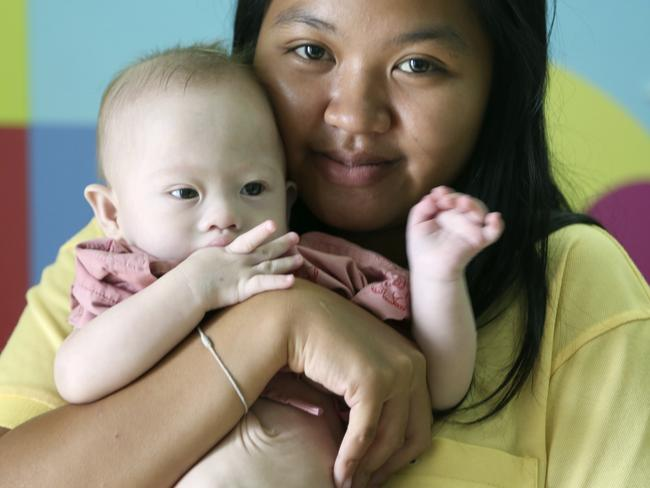Pattaramon Chanbua, 21, poses her baby boy Gammy. AP Photo/Apichart Weerawong