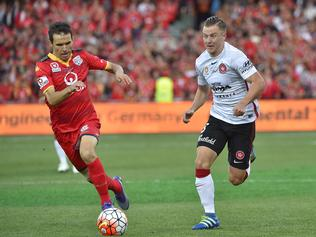 Isa'as S‡nchez of United and Scott Jamieson of the Wanderers during the A-League Grand Final between Adelaide United and the Western Sydney Wanderers at Adelaide Oval in Adelaide, Sunday, May 1, 2016. (AAP Image/David Mariuz) NO ARCHIVING, EDITORIAL USE ONLY