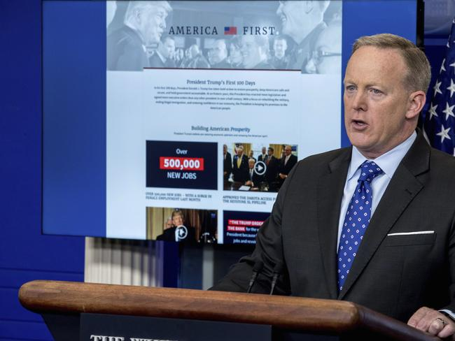White House spokesman Sean Spicer stands in front of the newly launched website celebrating Donald Trump's first 100 days. Picture: AP Photo/Andrew Harnik