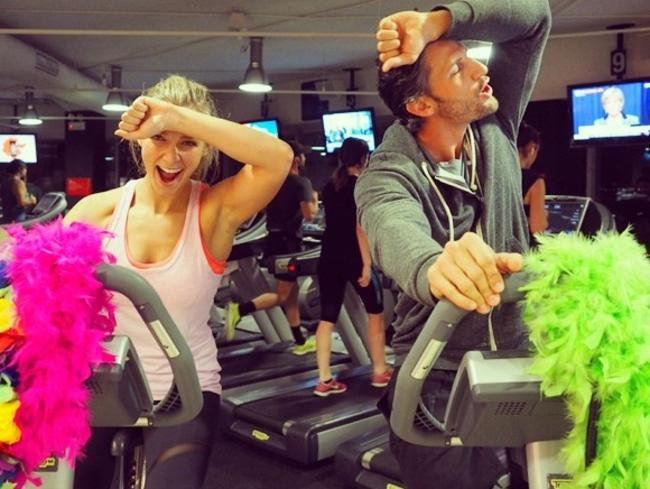"The bachelor couple Anna Heinrich and Tim Robards working up a sweat ""@fitnessfirstAU #KingsCross #12hourride to#ConquerCancer."" Picture: Instagram"