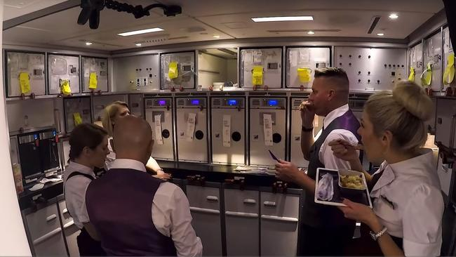 The crew grab a quick opportunity for their own meal. Picture: Virgin Atlantic