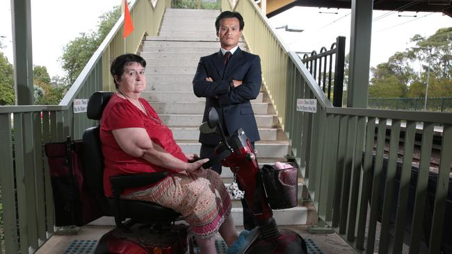 Macquarie Fields resident Rosemary Hoy and local MP Anoulack Chanthivong are lobbying the State Government to install a lift at Macquarie Fields railway station. Picture: Robert Pozo