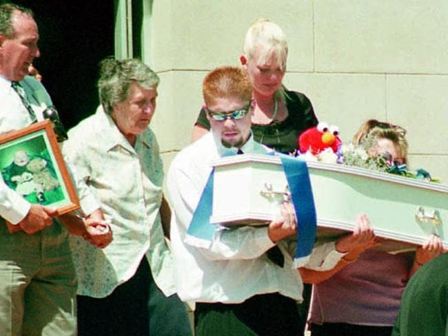 Baby Jordan in a white coffin is carried by grieving father Cecil Smith at the funeral before Christopher Hoerler was charged with the child's murder. Picture: Wagga Daily Advertiser.