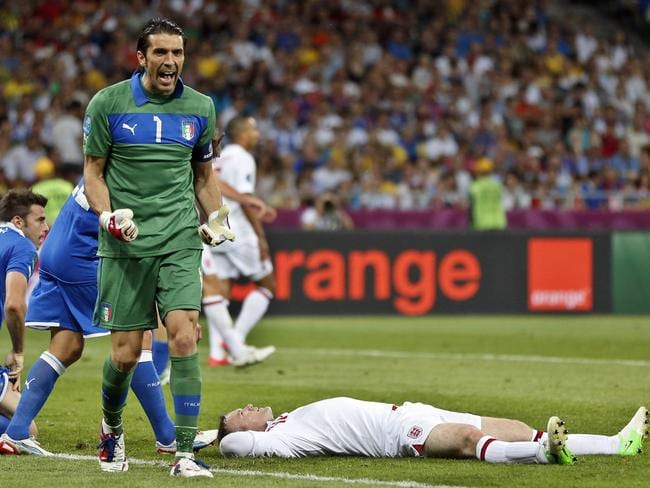 June 24, 2012 file photo Italy goalkeeper Gianluigi Buffon clenches his fists after England's Wayne Rooney, on the ground, missed a chance during the Euro 2012