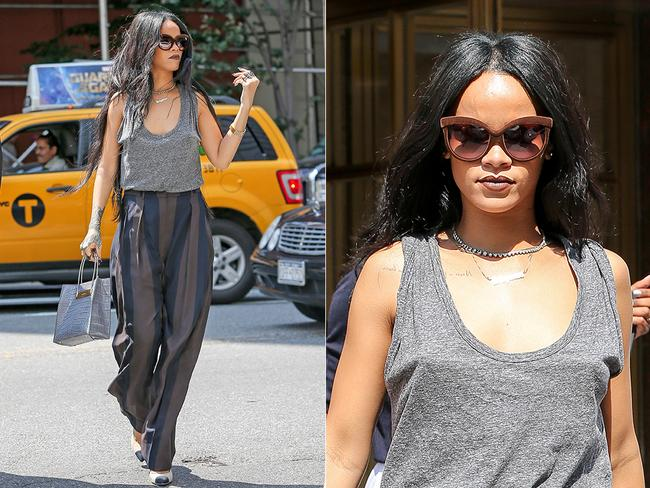 Rihanna steps up her fashion game wearing Alexander Wang, looking as if she just graced the covers of a fashion magazine. The Barbadian beauty went braless in a grey tank top and pinstriped slacks. Rihanna accessorised with a much-coveted grey Balenciaga crocodile print handbag and two-toned pumps, as her Rapunzel-like hair blew in the warm breeze. Picture: Splash