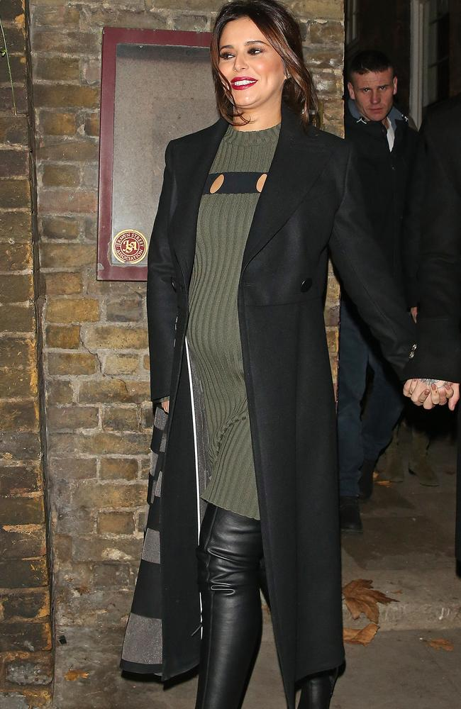 Cheryl Cole shows off a definite bump on a night out in London.