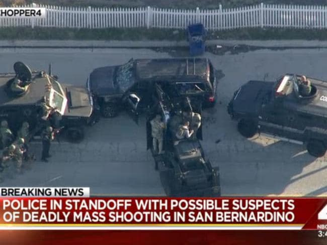 Final moments ... armored vehicles surround an SUV following a shootout in San Bernardino. Picture: KNBC via AP