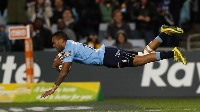 Alofa Alofa dives over to score a try for the Waratahs against the Brumbies at ANZ Stadium.