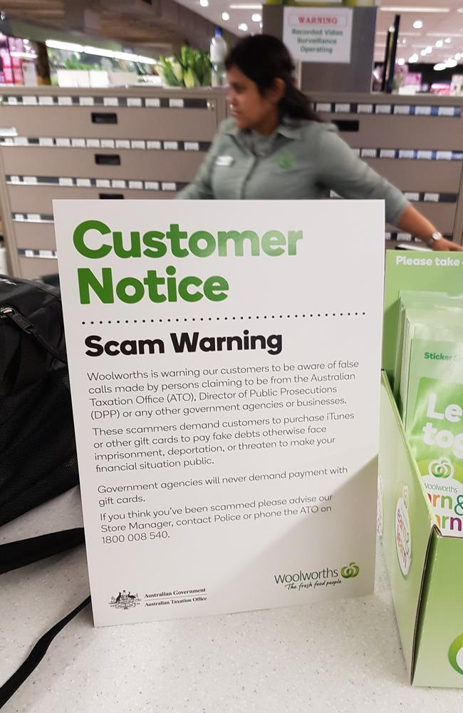 A scam warning displayed in Woolworths.