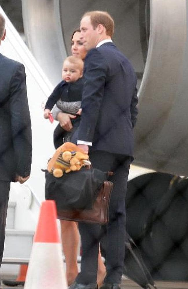 Prince William, Duchess of Cambridge Catherine and baby Prince George board a jet bound for New Zealand this morning at Sydney Airport. Picture: Bill Hearne
