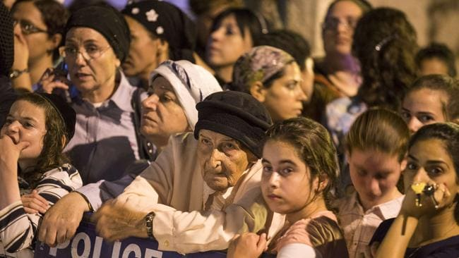 "Israelis gather in the Israeli city of El'Ad, outside the house of Eyal Yifrach ... any Israeli action to punish Hamas for the alleged murder of the three teenagers would open ""the gates of hell"", the Islamist movement warned. Picture: AFP/Jack Guez"