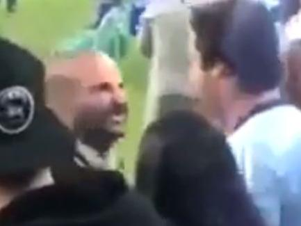 George Calombaris is mocked by a fan at the soccer.