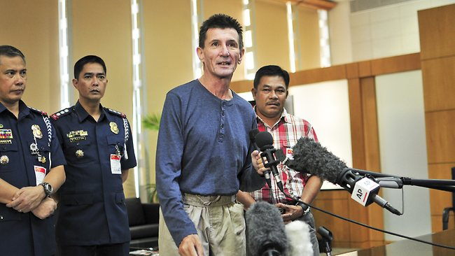 Australian national Warren Rodwell delivers a short statement to the media at Manila International Airport on March 25, 2013 in Manila, Philippines. (Photo by Veejay Villafranca/Getty Images)
