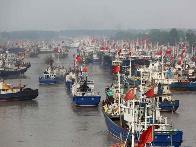 Fishing boats of China's fishing fleet — which is organised along militia lines — head out to sea from the port in Lianyungang, in China's eastern Jiangsu province. Picture: AFP