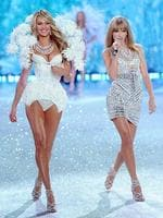 Victoria's Secret Fashion Show 2013: Singer Taylor Swift performs while angel Candice Swanepoel walks the runway at the 2013 Victoria's Secret Fashion Show. Picture: Getty