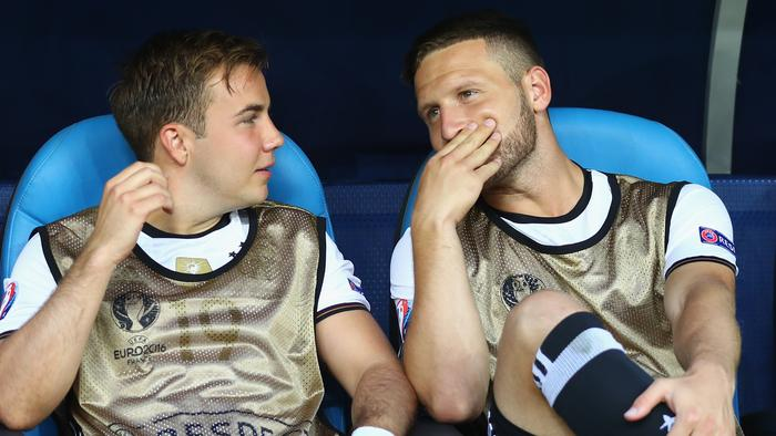 MARSEILLE, FRANCE - JULY 07: Mario Goetze (L) and Shkodran Mustafi of Germany talk on the bench prior to the UEFA EURO semi final match between Germany and France at Stade Velodrome on July 7, 2016 in Marseille, France. (Photo by Lars Baron/Getty Images)