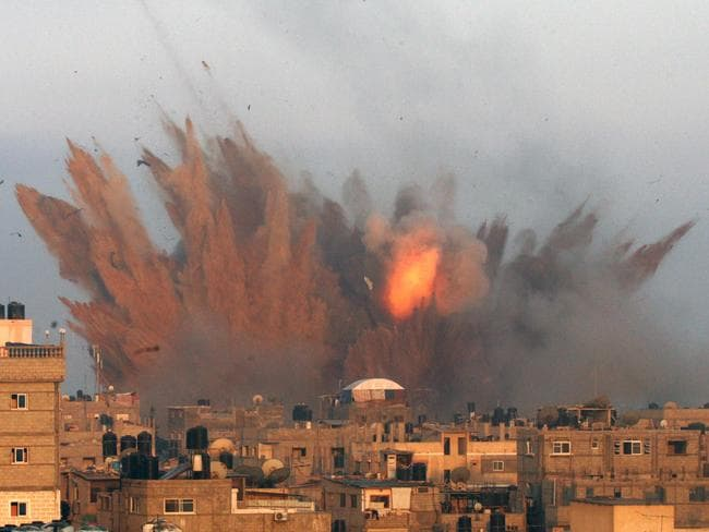 Deadly strikes ... a ball of fire is seen following an Israeli air strike in the Gaza strip.