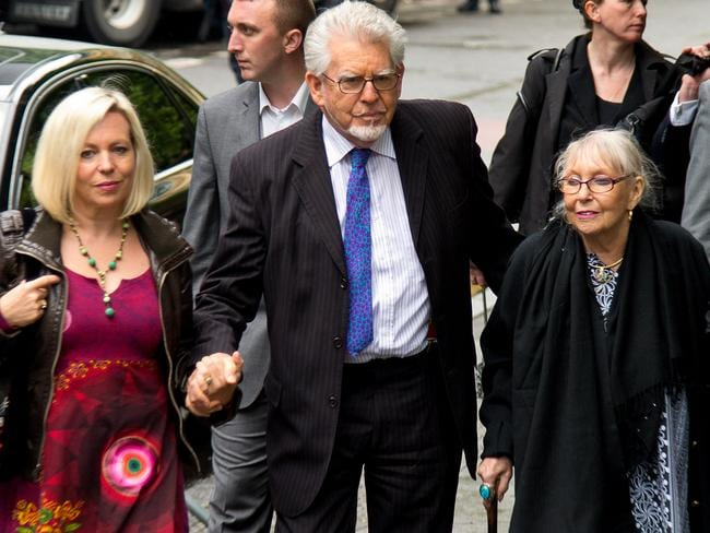 Family support ... Artist and television personality Rolf Harris arrives at Southwark Crown Court with his daughter Bindi Harris, left, and wife Alwen Hughes. Picture: Ben A. Pruchnie