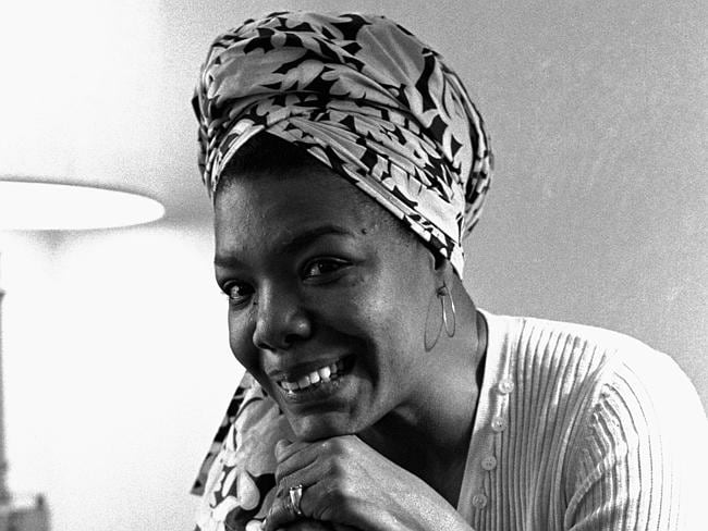 Maya Angelou poses with a copy of her book, I Know Why the Caged Bird Sings, in 1971.