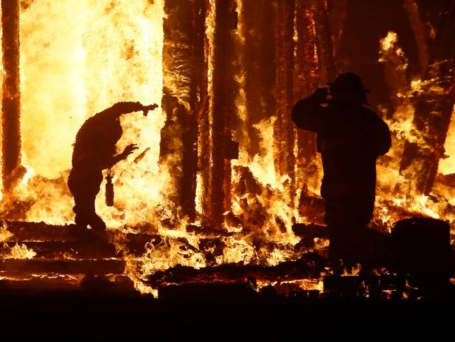 The man evades firefighters trying to stop him. Picture: REUTERS/Jim Bourg