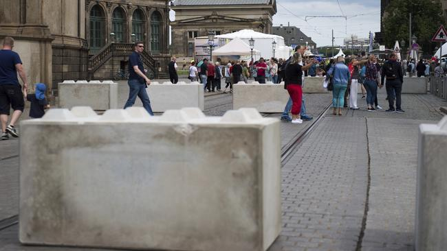 Many countries now feature bollards as part of anti terror measures. Concrete barriers stand at an access road to the city centre of Dresden, Germany, Saturday, Aug. 19. 2017. Picture: AP / Arno Burgi.