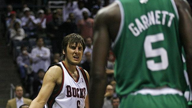 Andrew Bogut (L) and opponent Kevin Garnett face off after they exchanged blows during Milwaukee Bucks v Boston Celtic NBA game in Milwaukee.