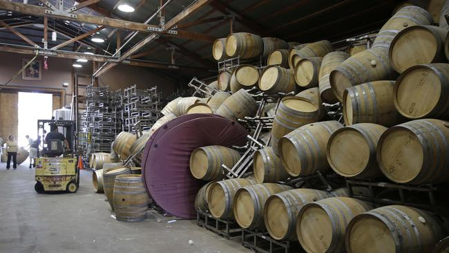 Wine mess ... Winemakers in California's Napa Valley woke up to thousands of broken bottles, barrels and gallons of ruined wine as a result of Sunday's earthquake. Picture: AP
