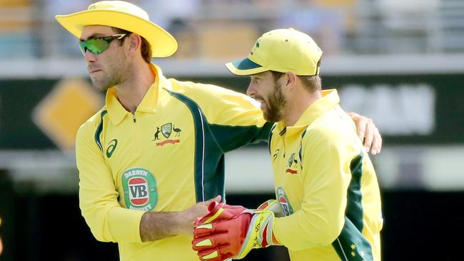 Glenn Maxwell and Matthew Wade in the field fo Australia. Picture: Jono Searle