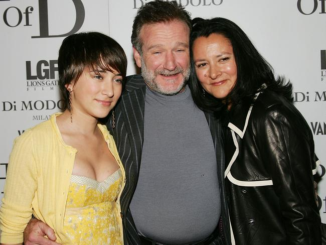 Robin Williams poses with his wife Marsha and daughter Zelda Williams. Picture: Evan Agostini/Getty Images.