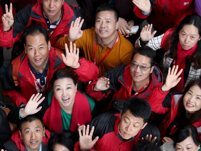 28.6.2017.Load of Chinese visitors in red vests - they are employees who won a sales competition and picked Adel as a place to visit, have been catching attention in their red vests. Leon Bignell with some of the Chinese visitors.  pic tait schmaal.