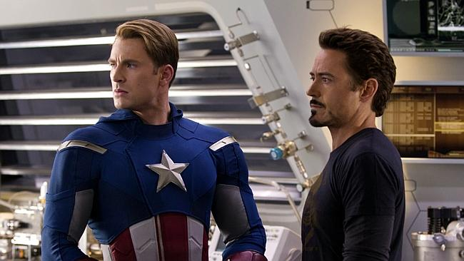 Chris Evans, portraying Captain America, left, and Robert Downey Jr., portraying Tony Stark, act in a scene from Marvel's 'The Avengers'.