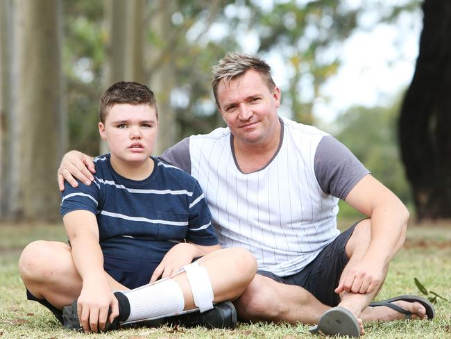 Layton, 14, and his father Troy, after the appeal began. Picture: Tim Hunter