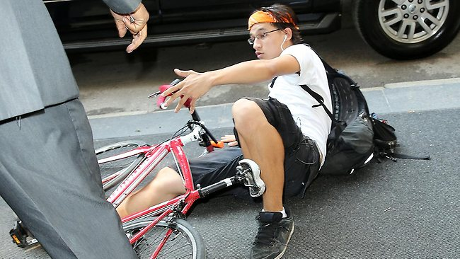 The photographer came off his bicycle and crashed to the pavement. Picture: Splash News