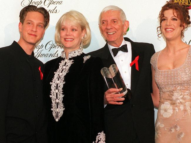 Multi-millionaire ...Aaron Spelling (third right) with from left, son Randy, wife Candy and daughter Tori.