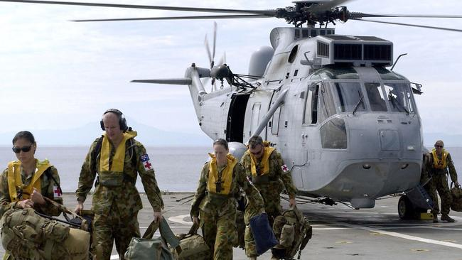 Help on the way ... Australian Defence Force doctors, nurses, medics, divers and hydrographers arrive in Sumatra to provide earthquake relief. Picture: AFP