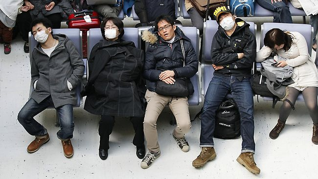 Many foreign travelers are stranded at Narita International Airport in Narita, east of Tokyo / AP