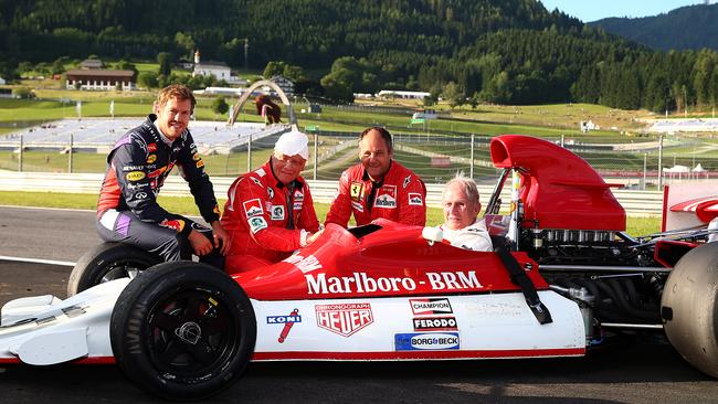 Vettel with Lauda, Berger and Marko.