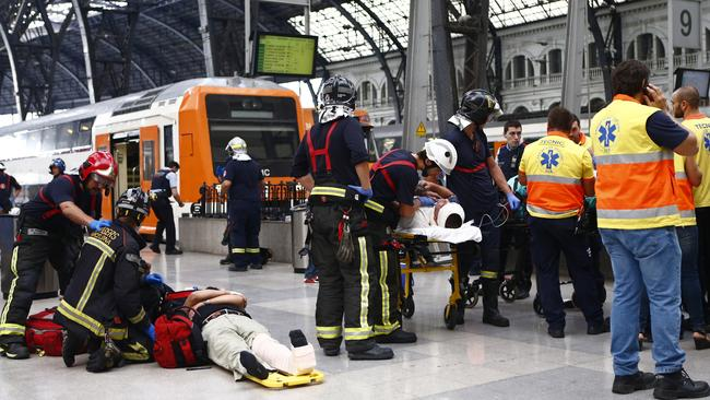 Injured passengers are attended to on the platform of a train station in Barcelona, Spain, Friday, July 28, 2017. Picture: AP /Adrian Quiroga.