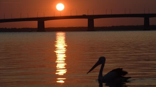 The sun rises over Captain Cook Bridge as Sydneysiders head toward a hot weekend. Picture: AAP Image/Dean Lewins.