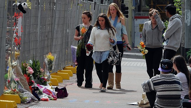 Friends leave flowers for Bridget Jones, 18, died in Royal Melbourne Hospital about 6.30am today.Alexander Jones, 19, had been hailed a hero after leaping to protect Bridget from falling debris during the tragedy in Swanston St on Thursday. Picture: Brownbill Andrew