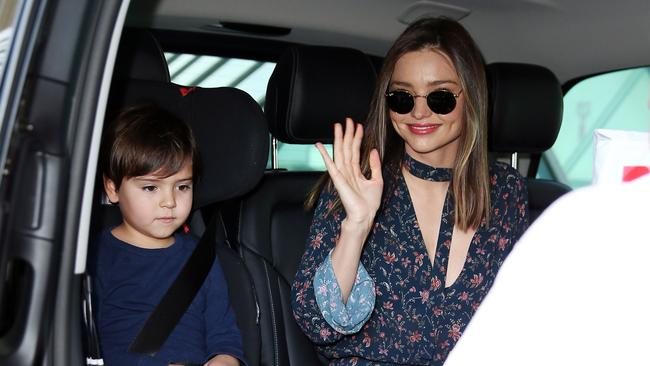 Miranda kerr and her son flynn arrive home in time for the festive