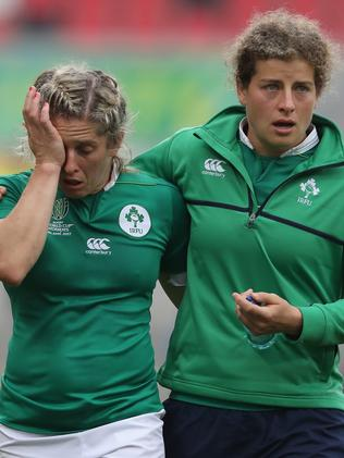 Alison Miller (L) of Ireland is comforted by a team mate after their defeat.