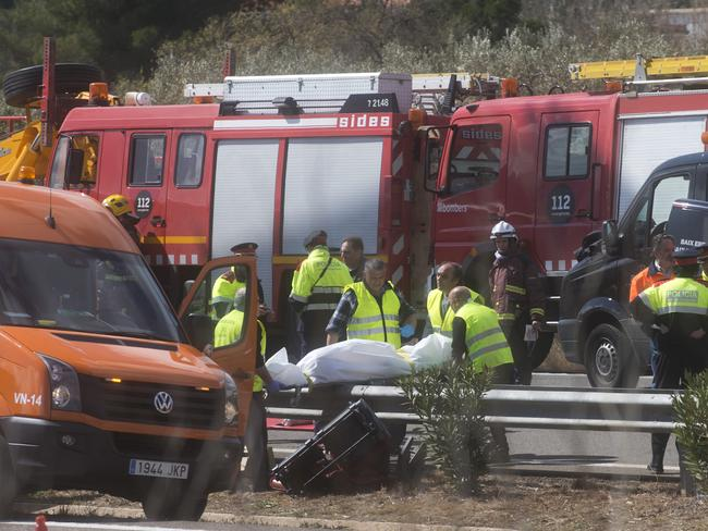 Fatalities ... emergency workers respond to the scene of a bus crash in Spain. Picture: AP