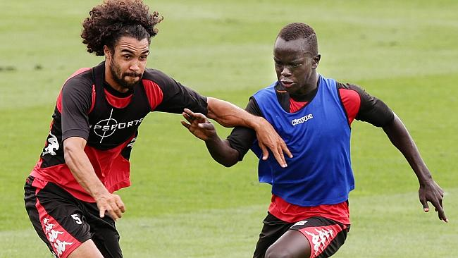 Osama Malik, left, and Awer Mabil at Adelaide United training. Picture: Sarah Reed.