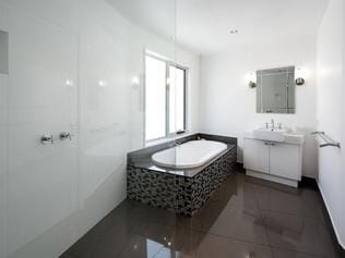 The pristine bathroom is crisp and modern.