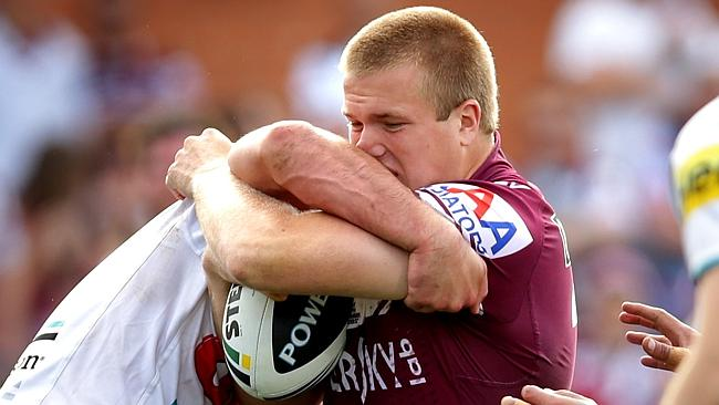 Manly prop Jake Trbojevic takes a strong hit-up against the Panthers.
