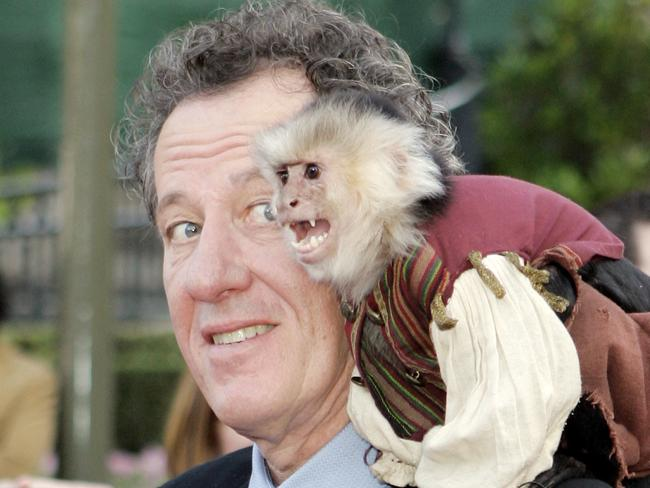 Geoffrey Rush with Jack the monkey. Picture: AP
