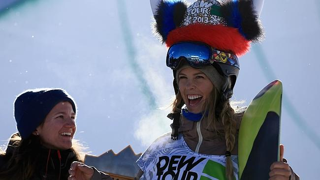 Torah Bright takes the podium after winning the women's snowboard superpipe final.